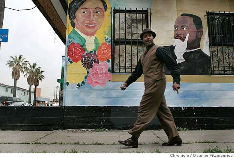 tookie_074_df.JPG  Reverend Dr. Lewis E. Logan, pastor of AME Bethel Church in South Central Los Angeles walks past a mural of Rosa Parks and Dr Martin Luther King Jr. Logan feels that Stanley Tookie Williams should not be executed next week. A group from his church went to the clemency hearing in Sacramento. Event in Los Angeles on 12/8/05.  Deanne Fitzmaurice / The Chronicle Photo: Deanne Fitzmaurice