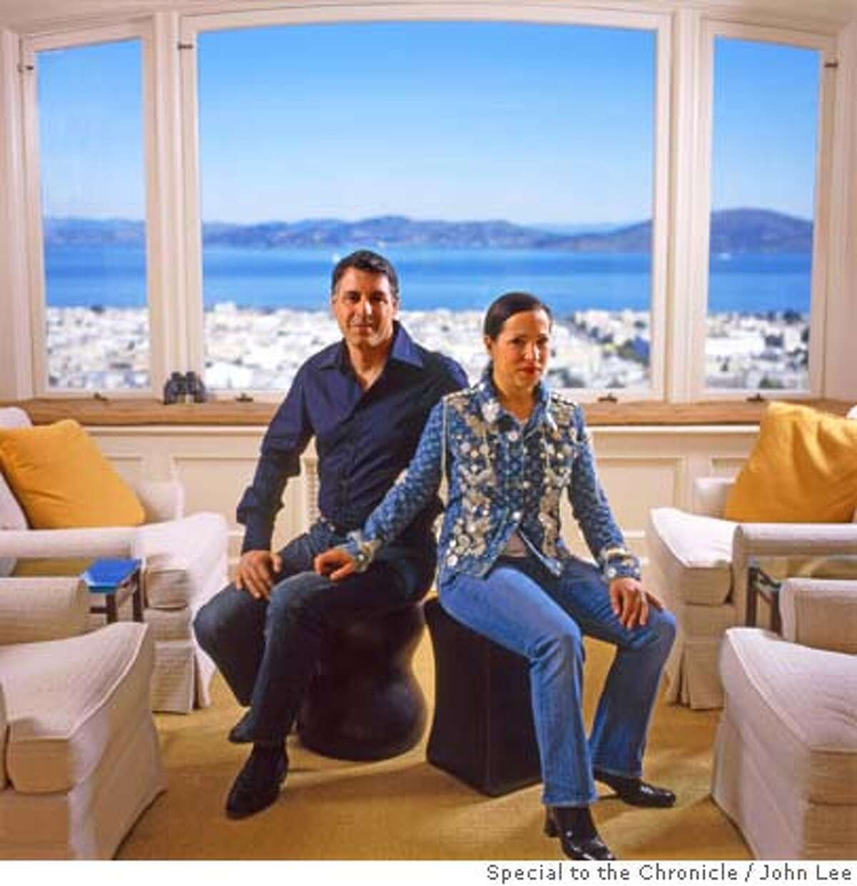 � 2500STEINER_KOUNALAKIS01JOHNLEE.JPG Markos Kounalakis (cq), left, and his wife Eleni Tsakopoulos-Kounalakis, sitting in the living room at 2500 Steiner in San Francisco's Pacific Heights. Behind them are windows looking north out onto the San Francisco Bay. For Sam Whiting story on 2500 Steiner. By JOHN LEE/SPECIAL TO THE CHRONICLE