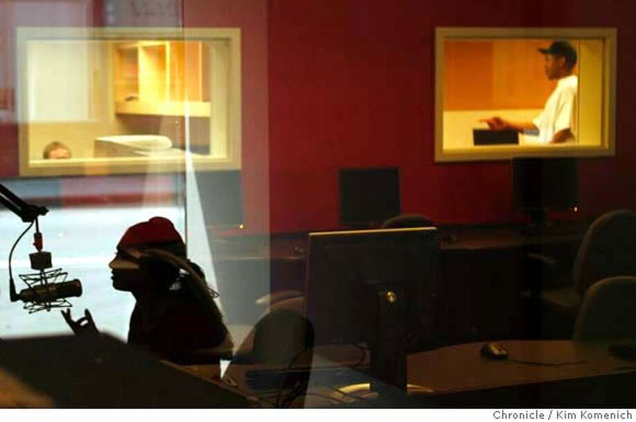 YOUTHRADIO03_026_KK.JPG  Youth Radio show host Hevanya Gardeen (in silhouette) does her live show in Youth Radio's new, larger studios at 1701 Broadway in Oakland.  Photo by Kim Komenich/The Chronicle  **Hevanya Gardeen �2007, San Francisco Chronicle/ Kim Komenich  MANDATORY CREDIT FOR PHOTOG AND SAN FRANCISCO CHRONICLE. NO SALES- MAGS OUT. Photo: Kim Komenich