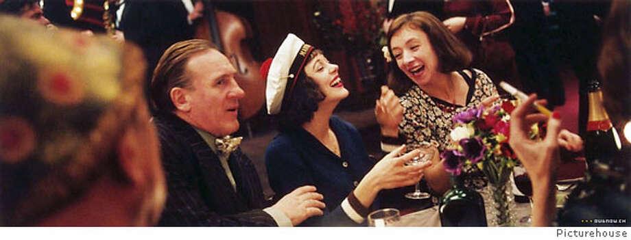 G�rard Depardieu, Marion Cotillard and Sylvie Testud in Olivier Dahan's LA VIE EN ROSE, Marion Cotillard plays Edith Piaf in the movie. Ran on: 04-22-2007 Ran on: 06-03-2007  Marion Cotillard, top center, is Edith Piaf in &quo;La Vie en Rose,&quo; with Gerard Depardieu and Sylvie Testud. Inset, director Olivier Dahan. Photo: 50th San Francisco International