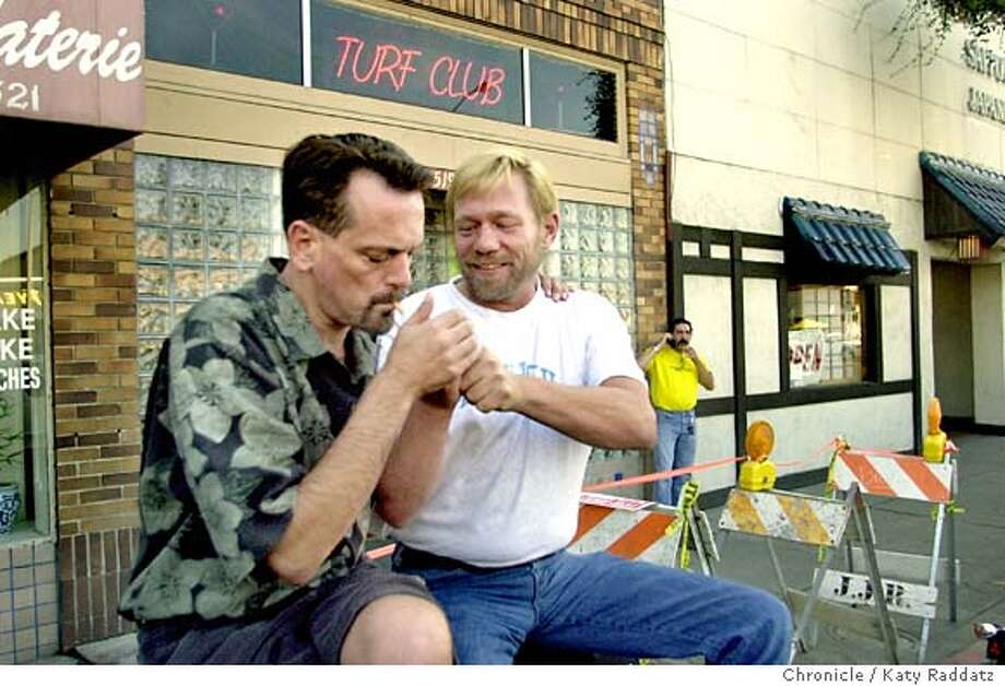 The town of Hayward celebrates gay pride with its own event on Sept. 13th. SHOWN: at The Turf Club, a gay bar on Main St. we see: L to R--Wayne Christiansen and Todd Morgan, who are best friends, enjoy some time alone in the back of Wayne's pickup truck while Todd has a cigarette. KATY RADDATZ / The Chronicle Photo: KATY RADDATZ