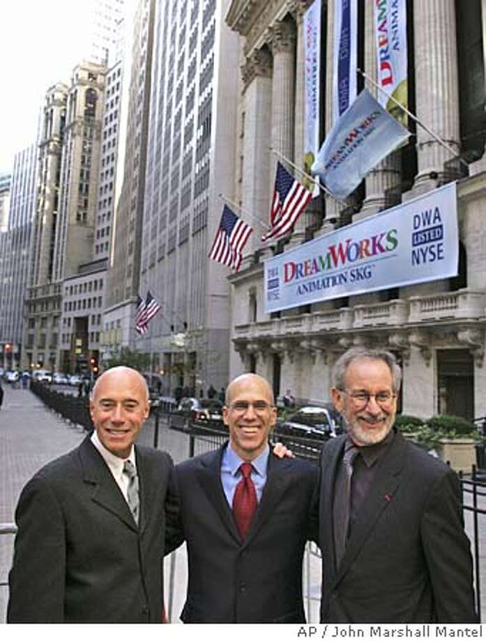 "DreamWorks founders David Geffen, left, Jeffrey Katzenberg, center, and Steven Spielberg celebrate the IPO outside the New York Stock Exchange, Thursday, Oct. 28, 2004. DreamWorks Animation Inc. shares rose well above their initial public offering price Thursday as trading began in stock of the company behind the recent hit films ""Shrek 2"" and ""Shark Tale"". (AP Photo/John Marshall Mantel) Photo: JOHN MARSHALL MANTEL"
