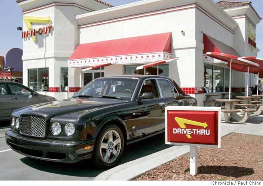 A lunchtime crowd gathered to admire a $271,000 2007 Bentley Arnage T at an In-N-Out burger restaurant in Oakland, Calif. on Thursday, March 29, 2007.  PAUL CHINN/The Chronicle MANDATORY CREDIT FOR PHOTOGRAPHER AND S.F. CHRONICLE/NO SALES - MAGS OUT Photo: PAUL CHINN
