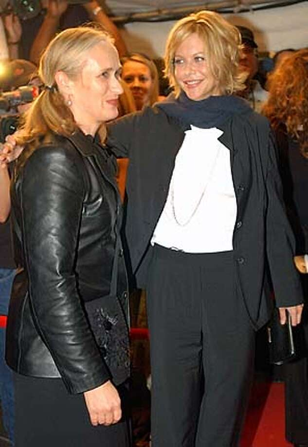 Meg Ryan, right, and director Jane Campion arrive for the premiere of In The Cut during the Toronto International Film Festival in Toronto Tuesday Sept. 9, 2003. (CP PHOTO/Aaron Harris) Photo: Aaron Harris