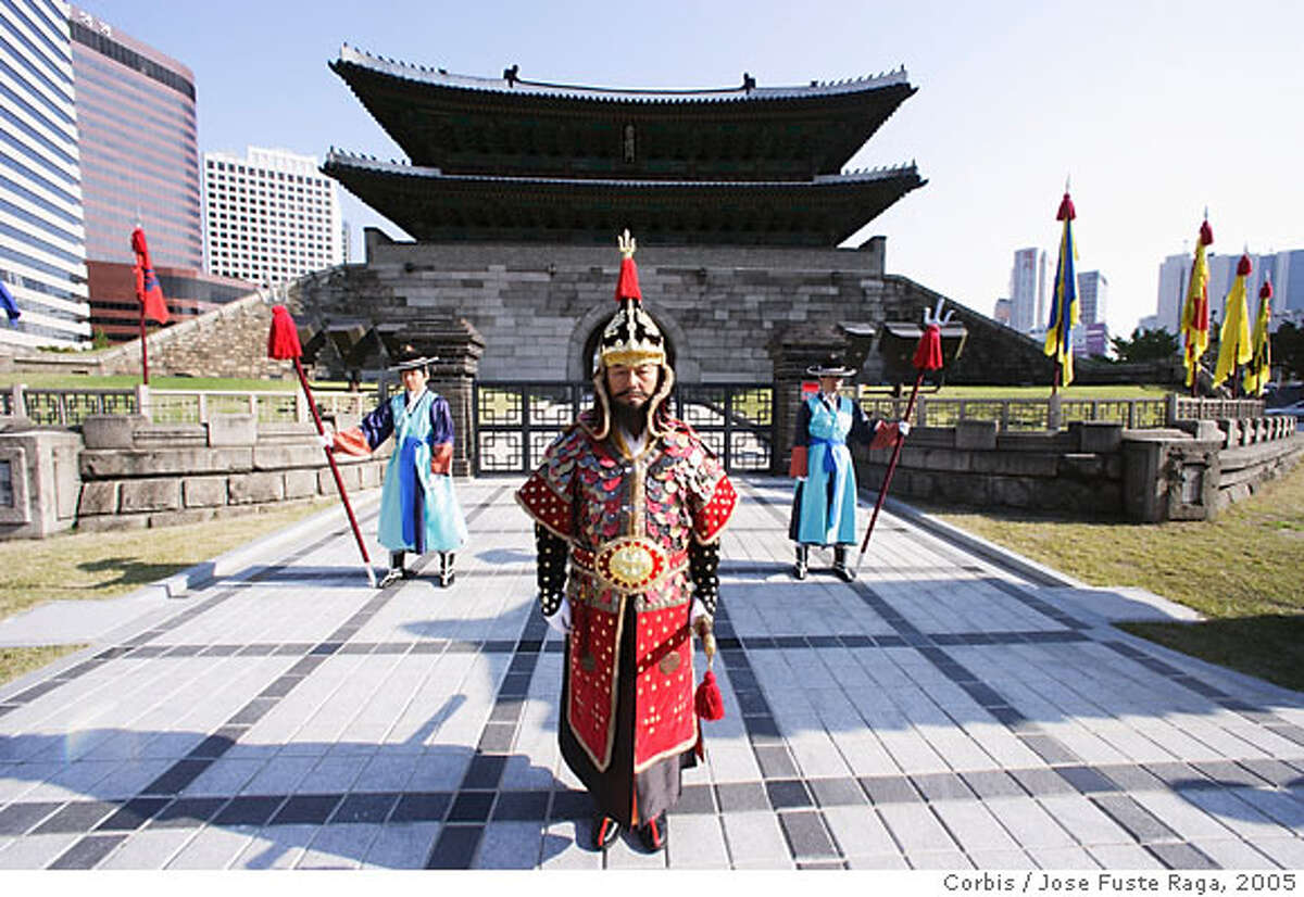 September 2005, Seoul, Korea --- Guards in Traditional Dress in Front of Namdaemun Gate --- Image by � Jose Fuste Raga/Corbis can use on internet