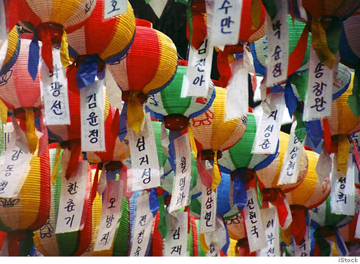 Paper lanterns at a Buddhist temple in Seoul, South Korea. These pieces of paper have the names of people on them. Anyone who wants to can