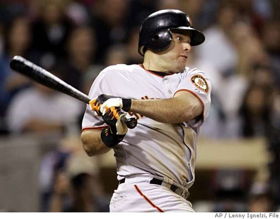 San Francisco Giants' J.T. Snow rips a hit to right field to drive in the go-ahead run in the ninth inning against the San Diego Padres Monday Sept. 26, 2005, in San Diego. Snow drove in two runs in the game as the Giants won 3-2 to close within three games of the Padres. (AP Photo/Lenny Ignelzi) Ran on: 09-27-2005 Photo: LENNY IGNELZI