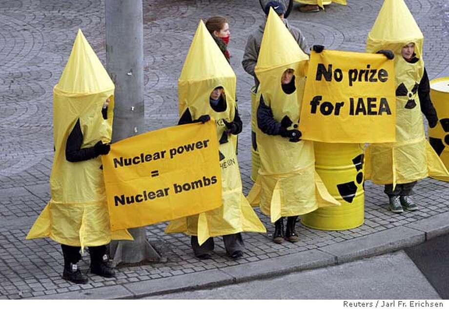 Members of Greenpeace stage a small demonstration outside the Nobel Institute as Director General of the International Atomic Energy Agency (IAEA) Mohamed ElBaradei (L) and Chairman of the Board of Governors Yukiya Amano speak at a news conference inside the building in Oslo December 9, 2005. ElBaradei, who will receive the Nobel peace prize with the IAEA on Saturday, said on Friday he hoped progress will be made to resolve a dispute with Iran over its nuclear programme in 2006. REUTERS/Jarl Fr. Erichsen /Scanpix DENMARK OUT SWEDEN OUT NORWAY OUT NO THIRD PARTY SALES Ran on: 12-10-2005  Greenpeace activists protest outside the Nobel Institute against the International Atomic Energy Agency receiving the Peace Prize. Photo: SCANPIX