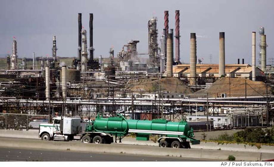A tanker truck passes in front of Chevron Refinery in Richmond, Calif., Thursday, April 28, 2005. ChevronTexaco Corp. said Friday, April 29, 2005, its profit rose slightly in the first quarter, but less than what Wall Street expected, as soaring prices for crude oil and natural gas were somewhat offset by a drop-off in refining and marketing results. (AP Photo/Paul Sakuma) Ran on: 04-30-2005  A tanker truck drives past the ChevronTexaco refinery in Richmond, where first-quarter production was reduced. Ran on: 04-30-2005  A tanker truck drives past the ChevronTexaco refinery in Richmond, where first-quarter production was reduced. Photo: PAUL SAKUMA