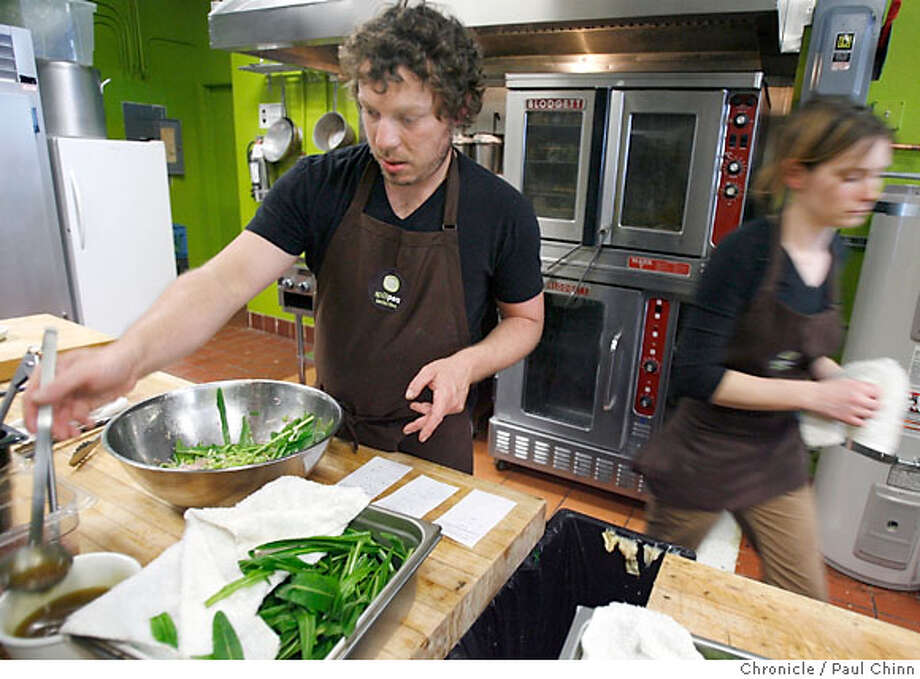 Christian Noto (left) and his business partner Sarah Pinkin work behind the scene at Split Pea Seduction take-out restaurant in San Francisco, Calif. on Friday, April 27, 2007. The start-up opened one week ago with the help of Urban Solutions which helps small businesses secure low cost loans.  PAUL CHINN/The Chronicle  **Christian Noto, Sarah Pinkin  Ran on: 06-03-2007  Christian Noto and Sarah Ellison-Pinkin work together at Split Pea Seduction. Photo: PAUL CHINN
