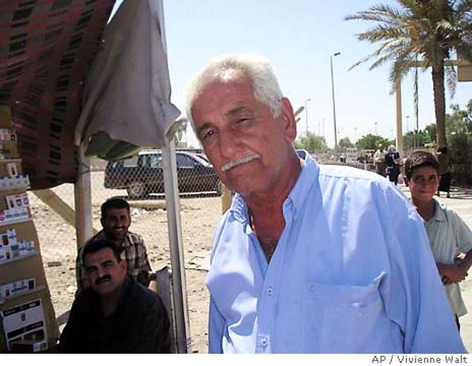 """For BAGHDAD 9/11, Foreign ; Rafiq Al Azawi, who runs an auto-paint workshop inBaghdad, says he remembers the """"happy feeling"""" on Iraqi television two years ago when the newscasters broke the news about the 9/11 attacks. Photo by Vivienne Walt ; Baghdad Sept 10 2003; on 9/10/03 in . Vivienne Walt / Special To The Chronicle Photo: Vivienne Walt"""