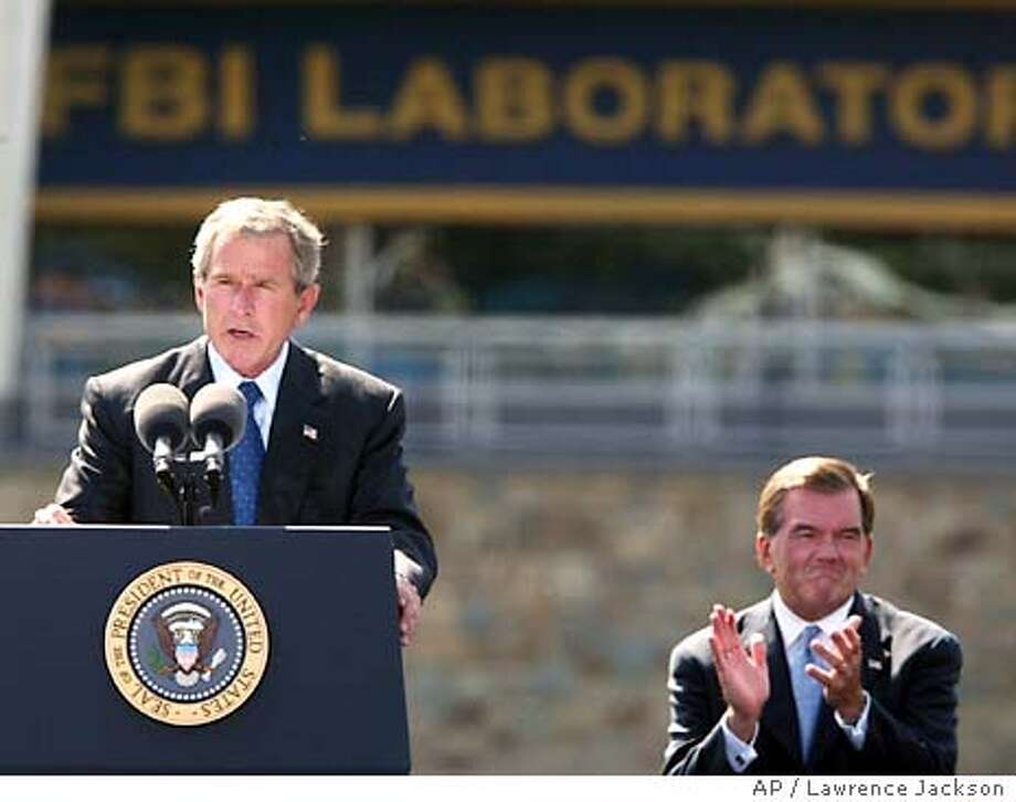 President Bush speaks at FBI headquarters with Secretary of Homeland Security Tom Ridge, on right, Wednesday, Sept. 10, 2003, in Quantico, Va. Bush spoke after touring the new FBI Laboratory. (AP Photo/Lawrence Jackson) Photo: LAWRENCE JACKSON