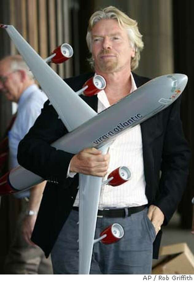 Sir Richard Branson stands outside a hotel in Sydney, Australia, Thursday, Dec. 8, 2005, holding a model Virgin Atlantic plane. Sir Branson is in Australia to celebrate the first-year anniversary of Virgin Atlantic's London-Australia route. (AP Photo/Rob Griffith) Photo: ROB GRIFFITH