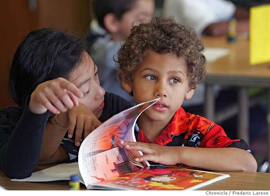 Angelica Chang teaches kindergartner Khalil Mitchell in her Mandarin immersion class at Starr King Elementary School. Chronicle photo, 2006, by Frederic Larson