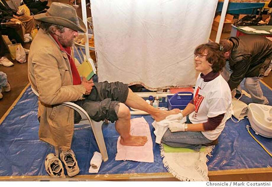 Susan Miiler, of CityTeam Ministries washes the feet of homeless man Dalibar Loric(cq) at the event.  San Francisco's home-grown Project Homeless Connect goes national on Thursday, with 21 cities around the country conducting their own versions of the city's popular bimonthly homeless-aid fair that day, and 10 more following suit in the ensuing month. Bush's national homelessness czar helped organize the national expansion, calling Connect � in which hundreds of volunteers gather for a day to help the city's homeless people get into housing or services -- one of the most innovative ideas for helping the homeless to come along in years. We will check in with events in SF and other cities to see how it goes. Event on 12/08/05 in San Francisco  Photo: Mark Costantini /San Francisco Chronicle Photo: MARK COSTANTINI