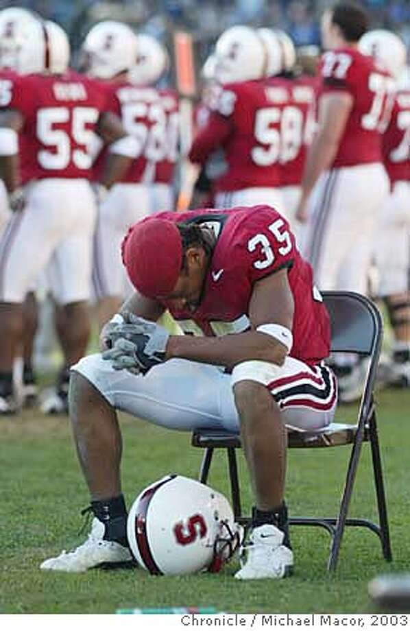 biggame014_mac.jpg Stanford's 35- T.J. Rushing as the seconds tick away. The Big Game. Stanford vs. California Berkeley College Football.  11/22/03 in Palo Alto. MICHAEL MACOR/ The Chronicle T.J. Rushing can't bear to watch as the final seconds tick away on any chance Stanford had at a bowl game. Photo caption biggame23_PH31069372800The Chroniclebiggame014_mac.jpg Stanford's 35- T.J. Rushing as the seconds tick away. The Big Game. Stanford vs. California Berkeley College Football._11-22-03 in Palo Alto. _MICHAEL MACOR- The Chronicle__MANDATORY CREDIT FOR PHOTOG AND SF CHRONICLE-NO SALES-MAGS OUT T.J. Rushing can't bear to watch as the final seconds tick away on any chance Stanford had at a bowl game. Photo caption biggame23_PH31069372800The Chroniclebiggame014_mac.jpg Stanford's 35- T.J. Rushing as the seconds tick away. The Big Game. Stanford vs. California Berkeley College Football._11-22-03 in Palo Alto. _MICHAEL MACOR- The Chronicle__MANDATORY CREDIT FOR PHOTOG AND SF CHRONICLE-NO SALES-MAGS OUT cat MANDATORY CREDIT FOR PHOTOG AND SF CHRONICLE/NO SALES-MAGS OUT Photo: MICHAEL MACOR