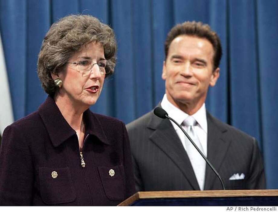 Gov. Arnold Schwarzenegger smiles as appellate judge Carol Corrigan talks to the media after he named her to the California , in Sacramento, Calif., Friday, Dec. 9, 2005. Corrigan, 57, a Republican sitting on the 1st District Court of Appeals in San Francisco, succeeds Justice Janice Rogers Brown who resigned in june after she the U.S. Senate confirmed her to the federal appeals court in Washington.(AP Photo/Rich Pedroncelli) Photo: RICH PEDRONCELLI