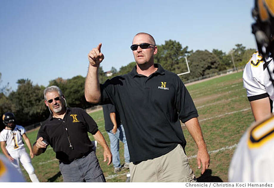 nbfootball01053_ckh.jpg (center)coach Travis Brackett coaches team. Novato has long been a force in MCAL football and now they are doing it with a stout defense. The story will outline how coach Travis Brackett has built such a strong unit, year after year. Please shoot coach Brackett and any of his defensive stars.  .  CHRISTINA KOCI HERNANDEZ/CHRONICLE Photo: CHRISTINA KOCI HERNANDEZ