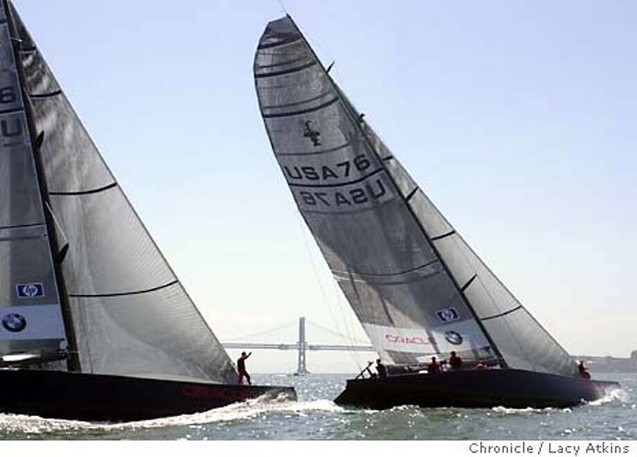 ORACLE039_la.jpg  Two 70 foot boats from the Oracle Racing Team practice for the up-coming Moet Cup Racing, along the San Francisco waterfront, Sept. 8, 2003. The Cup starts Sept. 15, 2003.  LACY ATKINS / The Chronicle Photo: LACY ATKINS