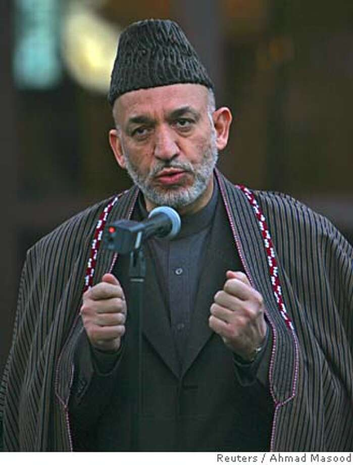 Afghan President Hamid Karzai reacts as he speaks over the killing of an Indian engineer in Kabul, Afghanistan, November 23, 2005. Afghan police on Wednesday found the body of an Indian man who Taliban insurgents said they kidnapped and executed, a provincial official said. REUTERS/Ahmad Masood 0 Photo: AHMAD MASOOD