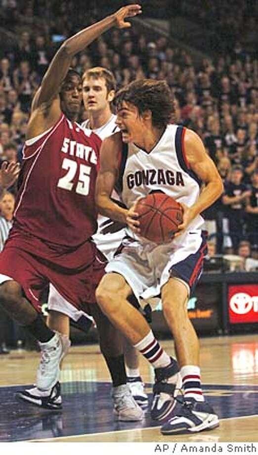Gonzaga's Adam Morrison struggles past Washington State University, Kyle Weaver, Thursday, Dec. 8, 2005, at McCarthy Center in Spokane, Wash. (Associated Press/Amanda Smith) Photo: AMANDA SMITH