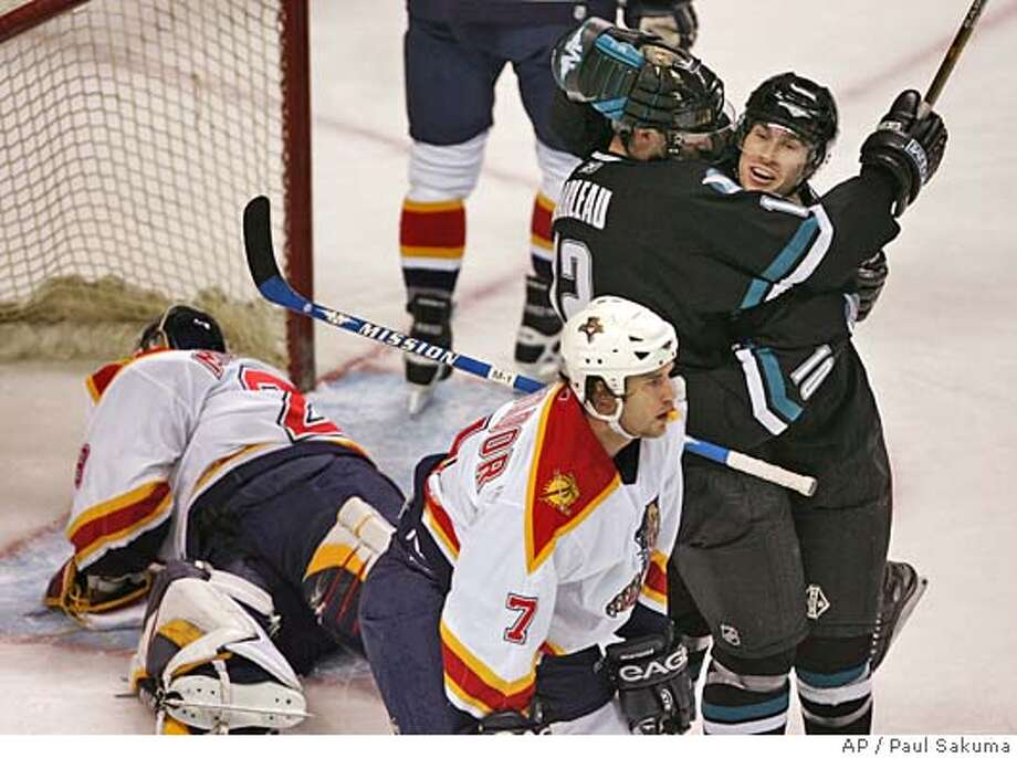 San Jose Sharks center Alyn McCauley, right, is congratulated by center Patrick Marleau, left, after McCauley scored past Florida Panthers goalie Jamie McLennan, left, in the first period, Thursday, Dec. 8, 2005, in San Jose, Calif. In foreground is Panthers defenseman Steve Montador. Marleau assisted on the score. (AP Photo/Paul Sakuma) Photo: PAUL SAKUMA
