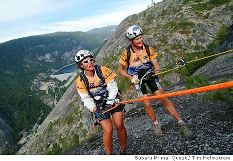 For ADRACETWO-11, sports ; (l-r) Kristina Stroude-Penny, Neil Jones of Team AROC rappel off Calaveras Dome into a river canyon of the Sierra as part of the Subaru Primal Quest race ; Photo credit: Subaru Primal Quest/ Holmstrom Photography/ Tim Holmstrom ; on 9/6/03 in . Tim Holmstrom / Subaru Primal Quest / Tim Holmstrom Photo: Tim Holmstrom