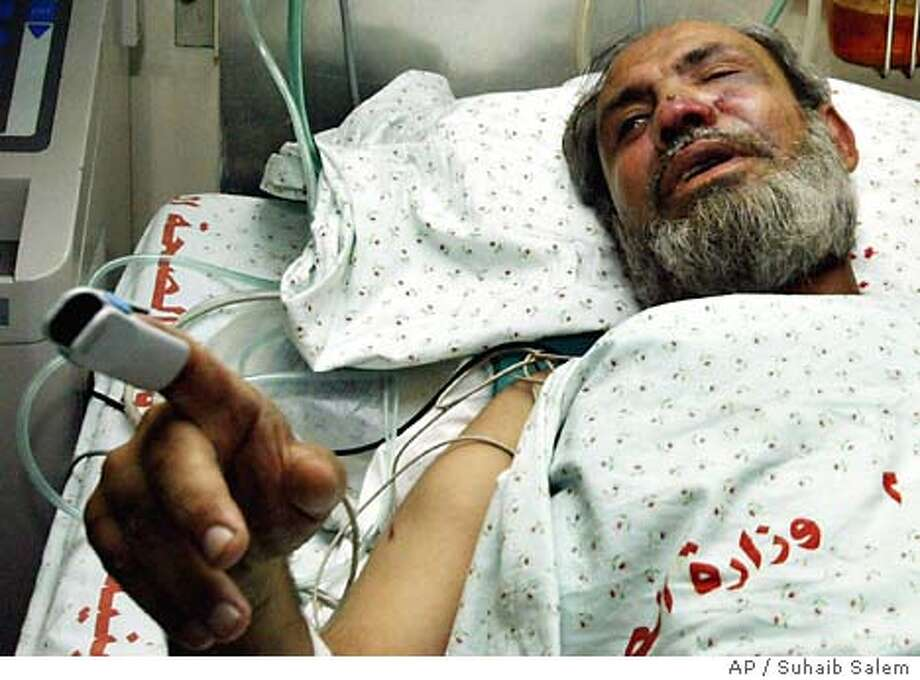 Hamas leader, Mahmoud Zahar lays in a hospital bed in Gaza Wednesday Sept. 10, 2003. An Israeli warplane narrowly failed in an attempt to assassinate the Hamas leader but killed his son and a bodyguard in the attack in Gaza on Wednesday, a day after two Palestinian suicide bombers killed 15 people in Israel. (AP Photo/Suhaib Salem, POOL) Photo: SUHAIB SALEM