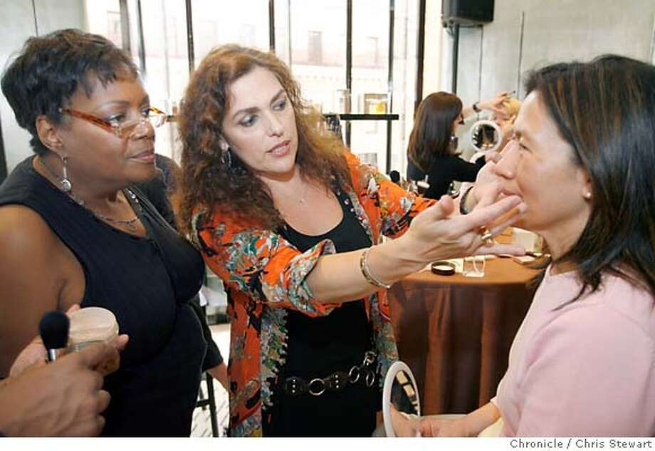 MERCIER03_0110_cs.jpg Event on 5/17/07 in San Francisco.  Laura Mercier (cq - center) offers makeup advice to Sophie Udomphol (cq - right) of San Jose as Mercier makeup artist Vera Oliver (cq) listens at left. Since 1996, Mercier has developed skin care, bath and body and fragrance lines, makes an appearance at Saks Fifth Avenue at Union Square in San Francisco to discuss skin care and then help clients with make-up application.  Chris Stewart / San Francisco Chronicle Laura Mercier, Sophie Udomphol, Vera Oliver MANDATORY CREDIT FOR PHOTOG AND SF CHRONICLE/NO SALES-MAGS OUT Photo: Chris Stewart