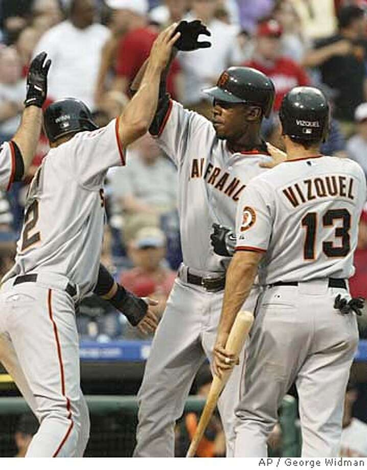 San Francisco Giants' Fred Lewis, center, is congratulated by Randy Winn, left, and Omar Vizquel, right, after his grand slam against the Philadelphia Phillies in the second inning of a baseball game in Philadelphia on Friday, June 1, 2007. (AP Photo/George Widman) Photo: George Widman