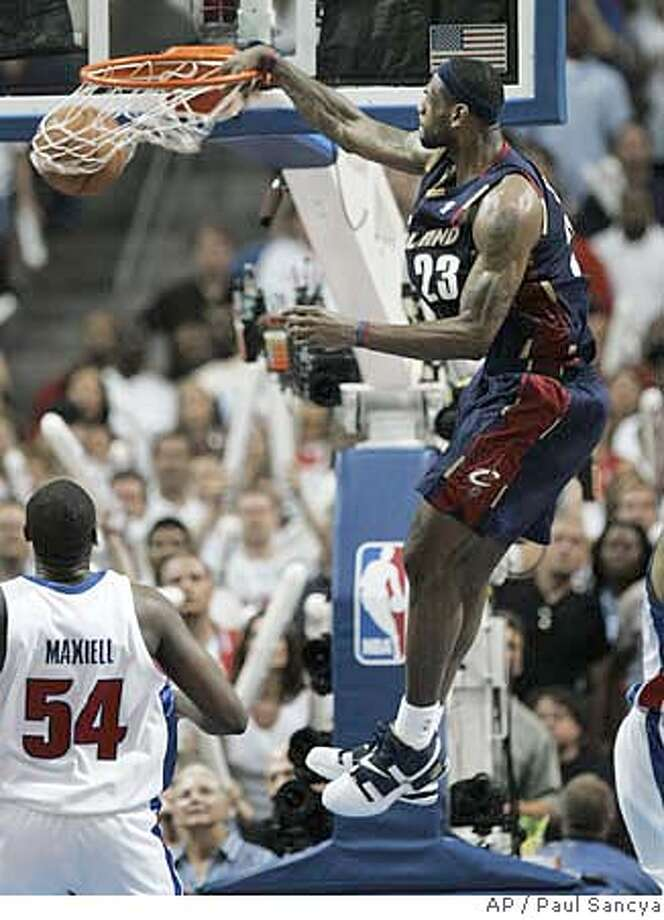 Cleveland Cavaliers' LeBron James dunks as Detroit Pistons defender Jason Maxiell looks onin the fourth quarter of their NBA Eastern Conference Final basketall game in Auburn Hills, Mich., Thursday, May 31, 2007. In Thursday night's 109-107 NBA playoffs victory in two overtimes over Detroit, James scored 48 points, including his team's final 25 and 29 of their final 30 points. (AP Photo/Paul Sancya) Photo: Paul Sancya
