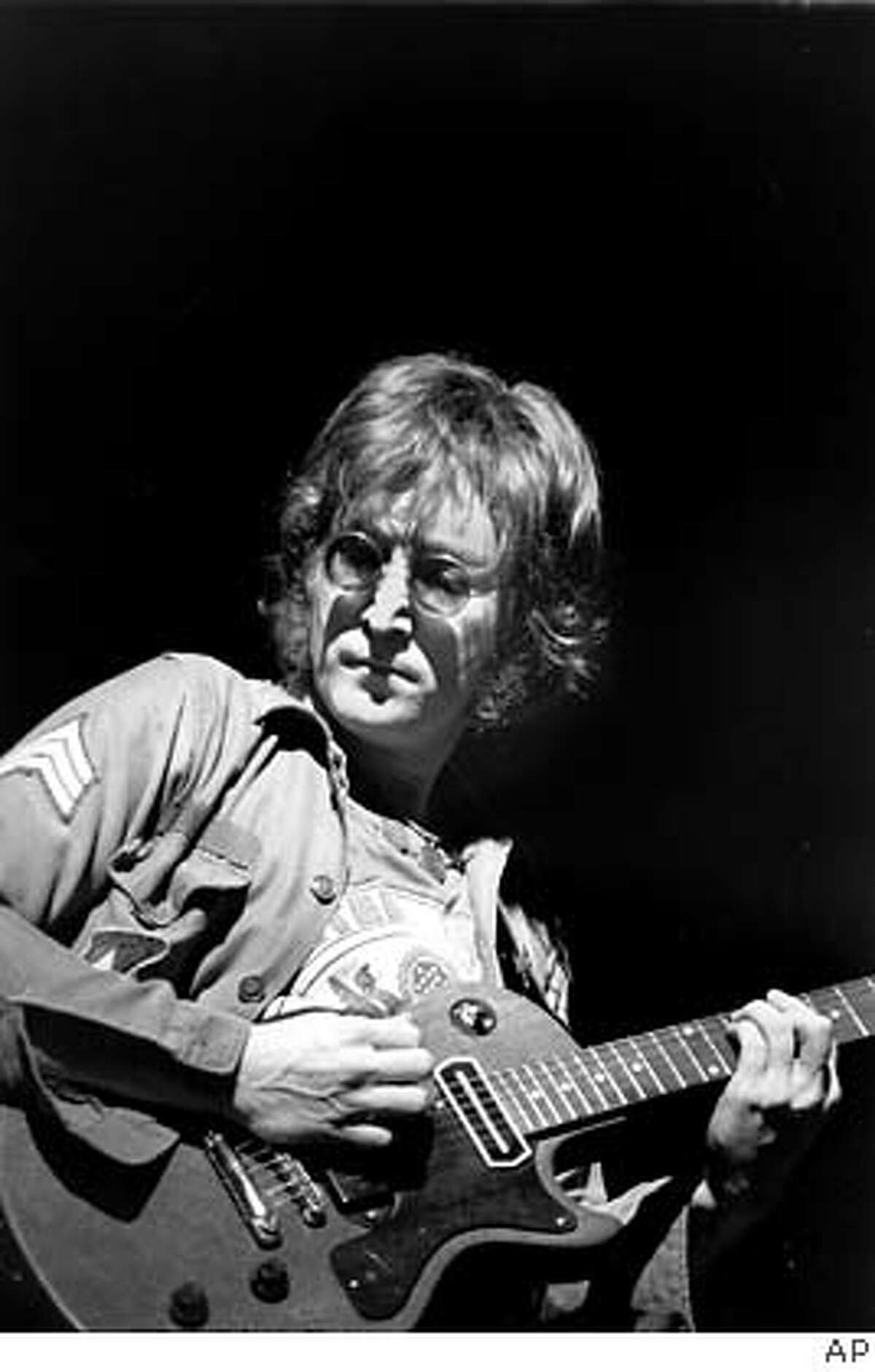 ** ADVANCE FOR SUNDAY, NOV. 20--FILE** Former Beatle John Lennon performs at New York's Madison Square Garden in this Aug. 30, 1972, file photo. It was Dec. 8, 1980 when Lennon was gunned down outside of his New York apartment. (AP Photo/File) HFR 11-20-05. ADVANCE FOR SUNDAY, NOV. 20. AUG. 30, 1972 FILE PHOTO