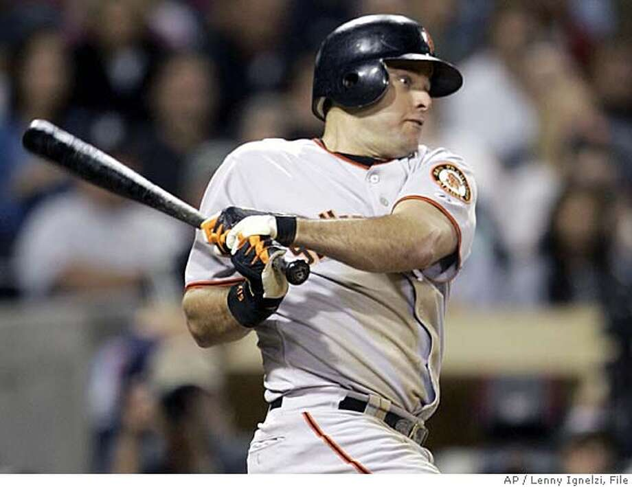 San Francisco Giants' J.T. Snow rips the game winning hit to right in the ninth inning against the San Diego Padres Monday Sept. 26, 2005 in San Diego. Snow drove in two runs in the game as the Giants won 3-2 to close within three games of the Padres. (AP Photo/Lenny Ignelzi) Photo: LENNY IGNELZI