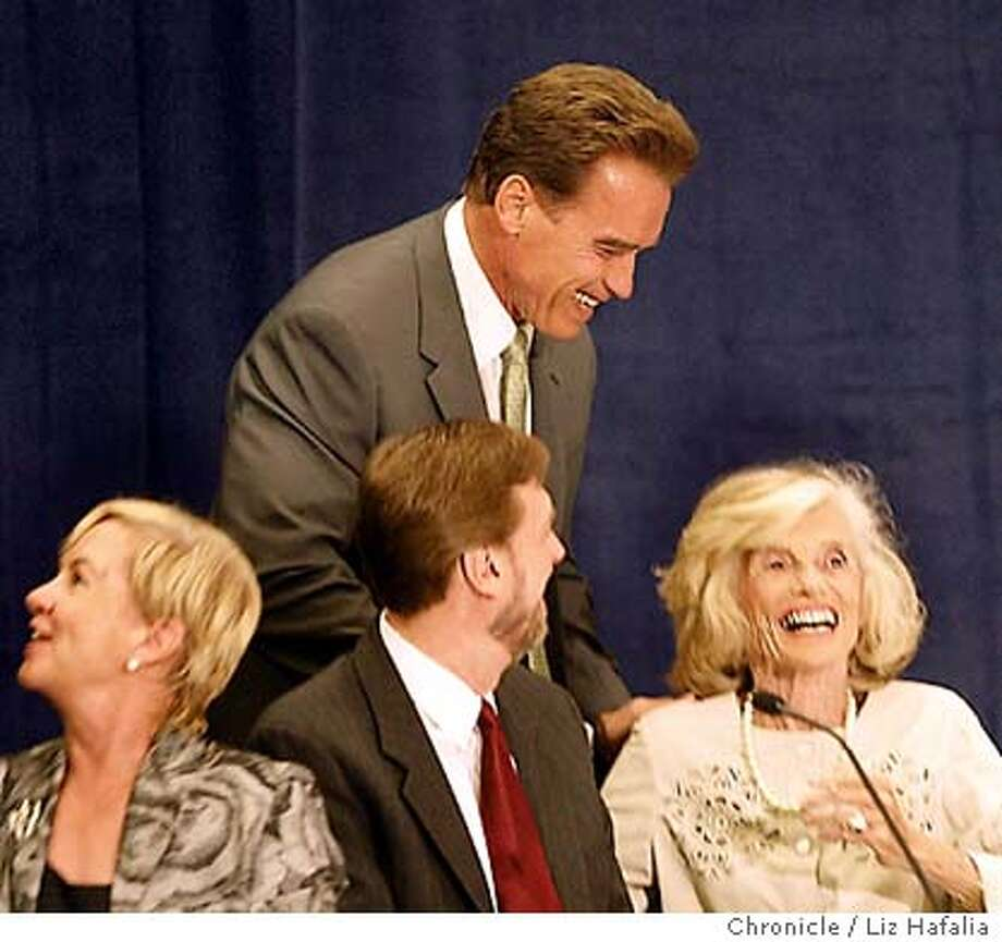 Arnold Schwrzenegger speaking at an education summit at the Marriott Hotel in downtown San Jose. Arnold Schwarzenegger greeting his mother in law Eunice Kennedy Shriver. Elizabeth Lowe at lower left and Michael Hardman at lower middle. Shot on 9/10/03 in San Francisco. LIZ HAFALIA / The Chronicle Photo: LIZ HAFALIA
