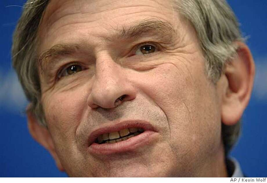 World Bank chief Paul Wolfowitz speaks at the National Press Club on Tuesday, Dec. 6, 2005 in Washington. In the speech Wednesday, Wolfowitz encouraged Doha negotiators to provide aid to improve trade institutions, services and infrastructure, trade policies that hinder competition in poor countries. (AP Photo/Kevin Wolf) A DEC. 6, 2005 PHOTO Photo: KEVIN WOLF