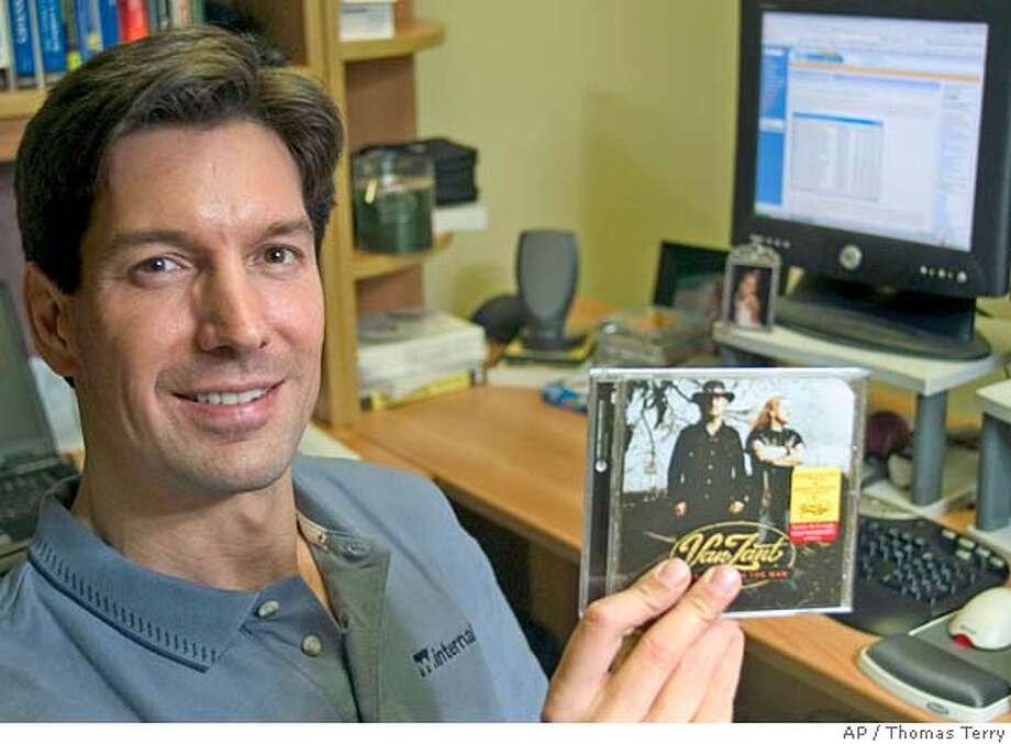 Mark Russinovich is shown in his office with his Van Zandt CD from Sony BMG Music Entertainment, in which he discovered that the company had added a copy protection technology called XCP to his computer, Friday, Nov. 18, 2005, in Austin, Texas. Russinovich posted his findings to his blog which generated serious attention, and eventually forced Sony BMG to recall 50 different discs this week. Some 4.7 million had been made and 2.1 million sold. (AP Photo/Thomas Terry) Photo: THOMAS TERRY