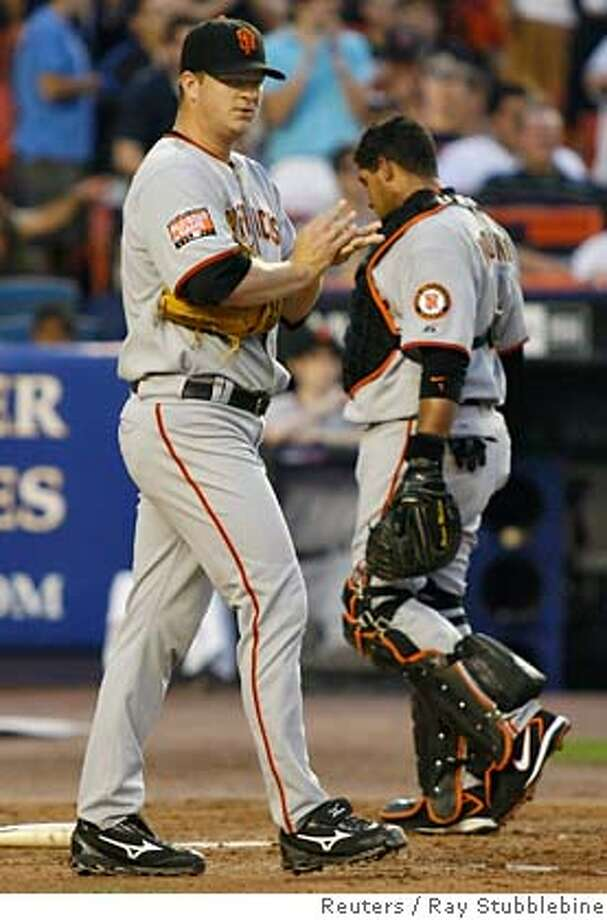 San Francisco Giants pitcher Matt Cain (L) and catcher Bengie Molina react after New York Mets runner Ben Johnson scored when Cain missed the throw to the plate to Molina in the second inning of their National League MLB baseball game in New York May 31, 2007. REUTERS/Ray Stubblebine (UNITED STATES) 0 Photo: RAY STUBBLEBINE