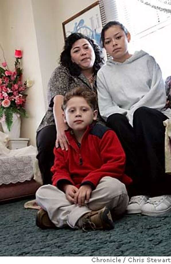 sos_fuentes070014.jpg Event on 12/2/05 in San Bruno.  Rosa Fuentes (left rear), her daughter Reny Fuentes, 15, and son Jonathan Miranda Fuentes, 6, in their San Bruno apartment. Season of sharing profile of Fuentes, a mother who has found housing after an abusive relationship but now needs equipment to help Jonathan, who is afflicted with cystic fibrosis. For further info: Rosa Fuentes at 650-583-2182, home.  Chris Stewart / The Chronicle MANDATORY CREDIT FOR PHOTOG AND SF CHRONICLE/ -MAGS OUT Photo: Chris Stewart