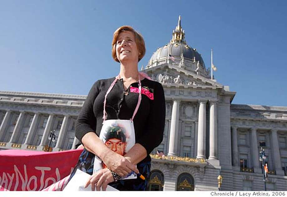 Anti-war activist Cindy Sheehan with a picture of her son Casey around her neck stands in front of the press to announce that she will not run against Dianne Feinstein in the Democratic U.S. Senate primary, Thursday Feb. 9, 2006, in San Francisco's Civic Center.  Photographer: Atkins, Lacy  Ran on: 06-01-2007  Gold Star mom Cindy Sheehan holds a picture of her son, Casey, who was killed in Iraq in 2004.  Ran on: 06-01-2007 Photo: LACY ATKINS