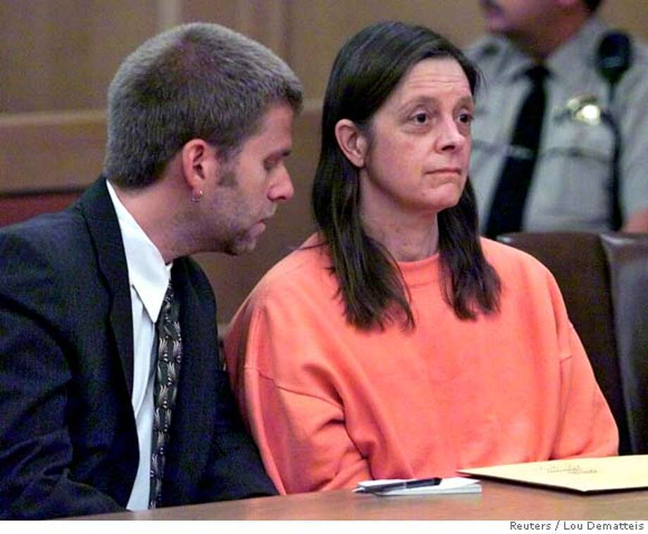 Marjorie Knoller (R) listens to her attorney Dylan Schaffer after hearing Superior Court Judge James Warren throw out her second degree murder conviction in San Francisco, June 17, 2002. A California judge on Monday threw out the second-degree murder conviction of a San Francisco woman whose attack dogs mauled a young neighbor to death last year, saying it was not certain the defendant knew her dog would explode in murderous fury that day. Superior Court Judge James Warren, however, let stand convictions handed down against Marjorie Knoller and her husband Robert Noel on lesser charges of involuntary manslaughter as he granted a defense motion for a new trial on Knoller's murder charge. REUTERS/Lou Dematteis CAT DIGITAL IMAGE Photo: LOU DEMATTEIS
