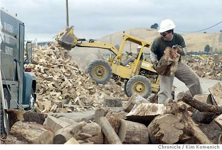9/9/03 in Martinez.  Employee Juan Garcia moves firewood to the log splitter.  John and Alyce Traverso's business, Traverso Tree Service is cited as a good example of an employer that is finding ways to keep up with rising medical plan costs. They have 17 employees and they dealt with this year's 8% hike by increasing employee co-pays. KIM KOMENICH / The Chronicle Photo: KIM KOMENICH