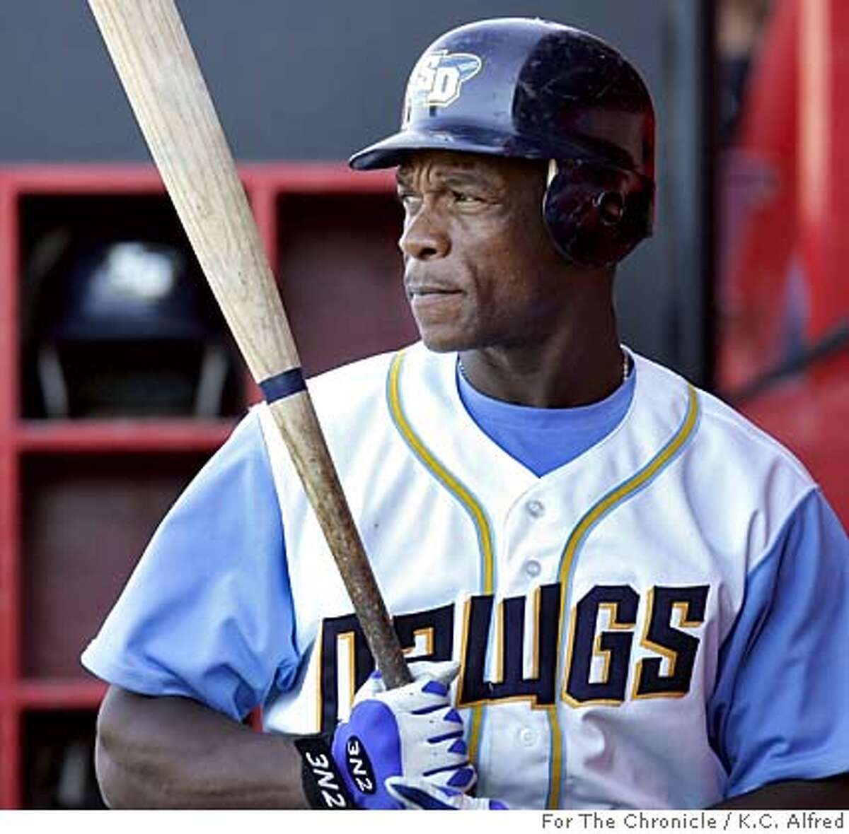 San Diego Surf Dawgs' Rickey Henderson gets ready to bat during a game against Chico on Wednesday, June 29, 2005. After 25 years in the major leagues, Henderson is playing in the Golden Baseball League. Photo by K.C. Alfred/For The Chronicle 619-733-9804 kc.alfred@uniontrib.com Ran on: 07-03-2005 Ricky Henderson, 46, is batting .302 and hoping for a fifth go-round with the As. Ran on: 07-03-2005 Ricky Henderson, 46, is batting .302 and hoping for a fifth go-round with the As. Ran on: 07-03-2005 Ran on: 07-03-2005 Ricky Henderson, 46, is batting .302 and hoping for a fifth go-round with the As.