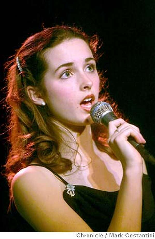 "JUDY_120_mc.jpg  15-year-old Judy Butterfield(seen here singing) makes her headline debut at the Empire Plus Room performing ""Judy Sings Judy: Songs of a Young Garland."" Her three-night appearance (April 16-18) at the Plush Room isn't an imitation of the great star, but is a tribute to Garland, by the former ACT Conservatory talent who's a freshman at Urban High School in SF.  Mark Costantini/San Francisco Chronicle MANDATORY CREDIT FOR PHOTOG AND SF CHRONICLE/NO SALES-MAGS OUT Photo: Mark Costantini"