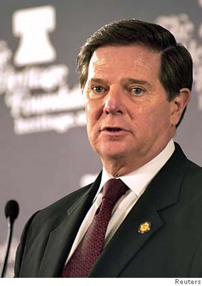 Former House Majority Leader Tom DeLay speaks during a public gathering at the Heritage Foundation near Capitol Hill in Washington in this November 3, 2005 file photo. A Texas judge upheld an indictment charging DeLay with money laundering on December 5, 2005, but agreed with the Republican lawmaker that conspiracy charges should be dismissed. REUTERS/Stringer/Files 0 Photo: STRINGER/USA