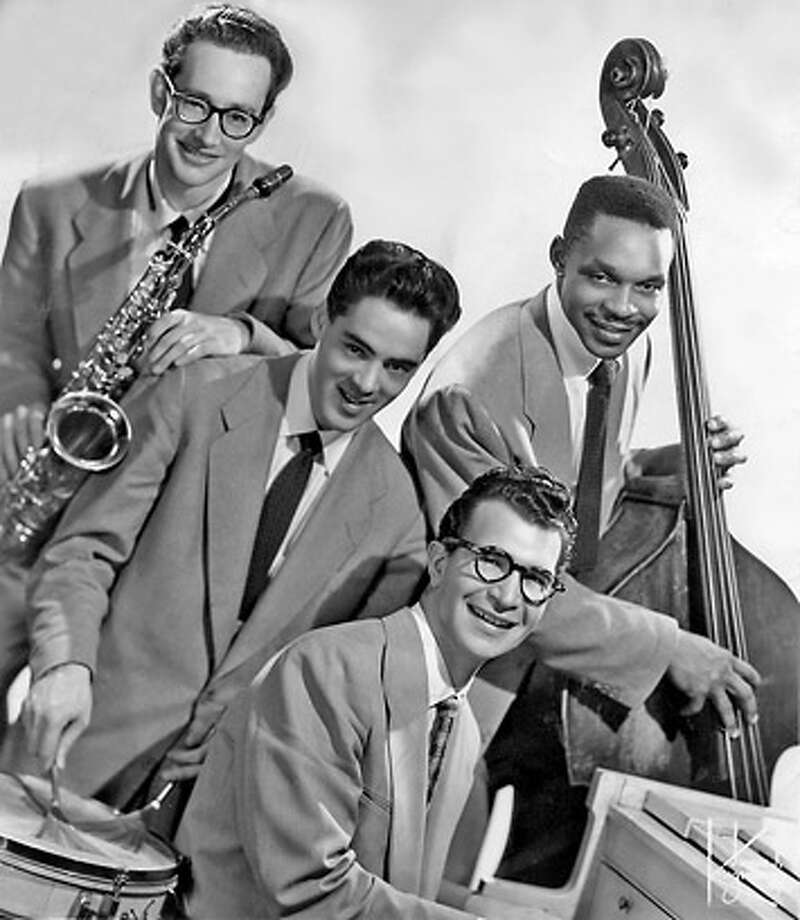 Dave Brubeck (front) worked with a black bass player,