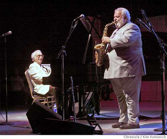 Dave Brubeck, left,  comps to a sax solo by Bobby Militello during a show in California in 2005. Photo: Kim Komenich