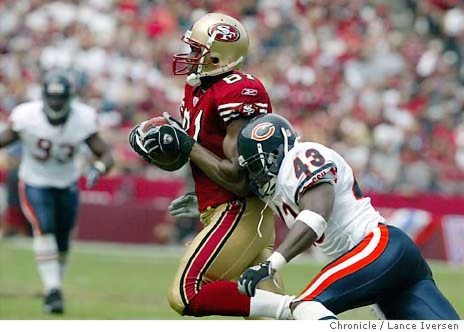 49ers_001_LI.JPG  San Francisco 49ers vs the Chicago Bears. Noners Terrell Owens hauls in a first down pass over Bears Mike Green. Photo by LANCE IVERSEN, The San Francisco Chronicle Photo: Lance Iversen