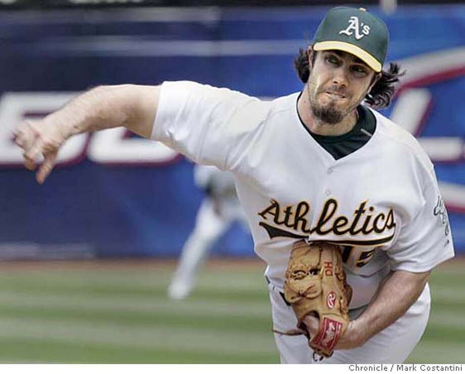 A's pitcher Dan Haren en route to his win over the Texas Rangers.  A's v. Texas Rangers at the Coliseum  PHOTO: Mark Costantini / The Chronicle MANDATORY CREDIT FOR PHOTOGRAPHER AND SAN FRANCISCO CHRONICLE/NO SALES-MAGS OUT Photo: MARK COSTANTINI