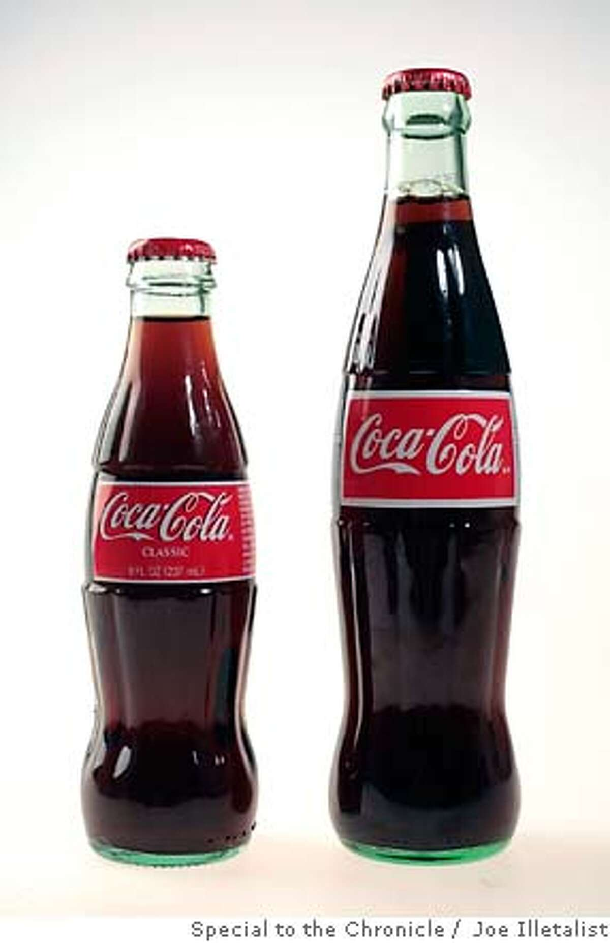 WHATS30_COKE_04_JOHNLEE.JPG Mexican and American Coke bottles. By JOHN LEE/SPECIAL TO THE CHRONICLE