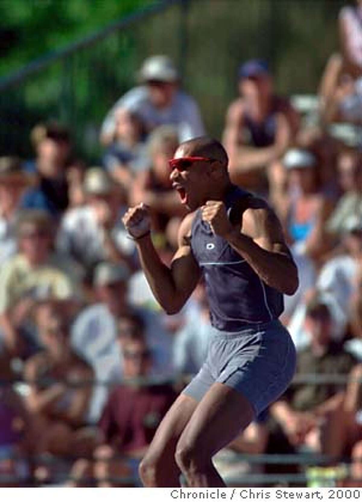 TRACK-HUFFINSYELL-21JUL00-SP-CS Decathlon leader Chris Huffins shouts at missing on his final jump at 4.70 meters in the men's decathlon pole vault at the 2000 U.S. Olympic track and field trials at Cal State Sacramento. Huffins finished in seventh place and holds a slim lead over Tom Pappas, who placed second in the pole vault. Only two events remain. BY CHRIS STEWART/THE CHRONICLE